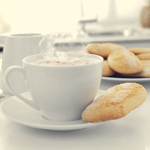 cappuccino and biscuits on the kitchen table
