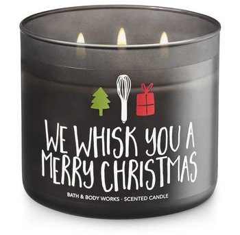 We whisk you a merry Christmas candle