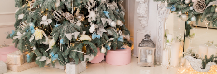 Christmas Tree in pink room with presents
