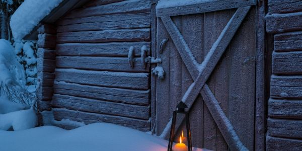 cold barn in morning with snow and candlelight