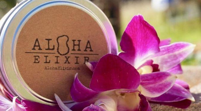 Aloha Elixir tin travel candle in purple flowers