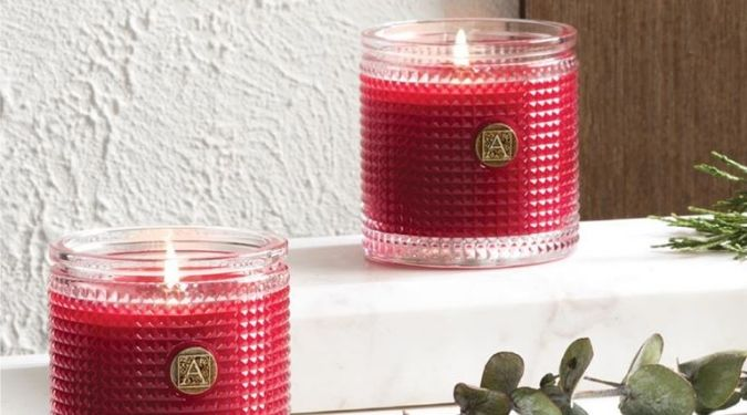 Aromatique luxury candle red wax textured glass on ledge