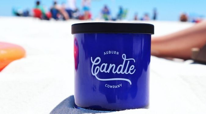 Auburn Candle Company blue candle vessel on beach