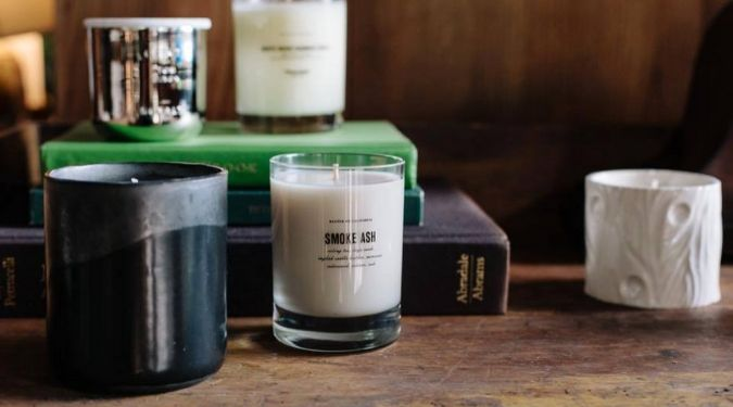 white soy candles on books baxter of california
