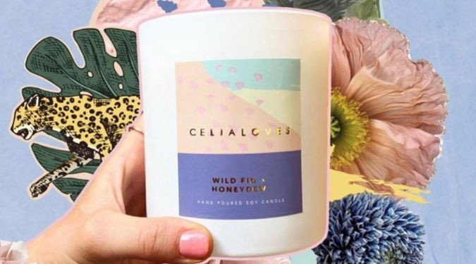 mae and june at celia loves candle white vessel colorful label with floral background