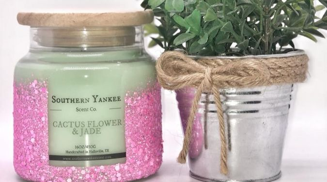pink glitter candle jar with wooden lid near plant silver container southern yankee scent company