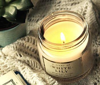 white candle burning near book