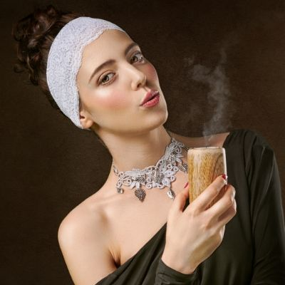 Cool woman holding candle blowing out wick