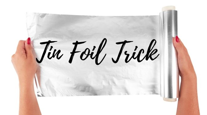 woman with red fingernail polish holding roll of tin foil with words tin foil trick