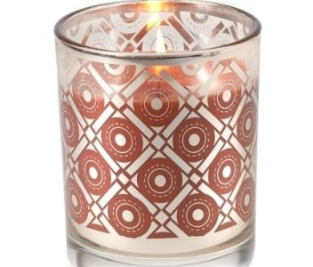 Aromatique pumpkin spice holiday candle burning brown circles